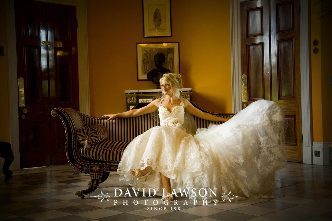 Image showing a bride posing on a chair at Wynyard Hall